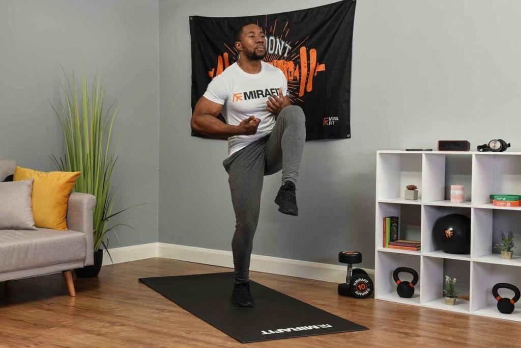 Mirafit fitness model demonstrating the high knees exercise