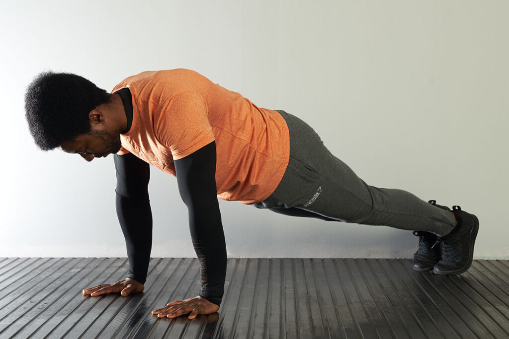 Man performing a high plank