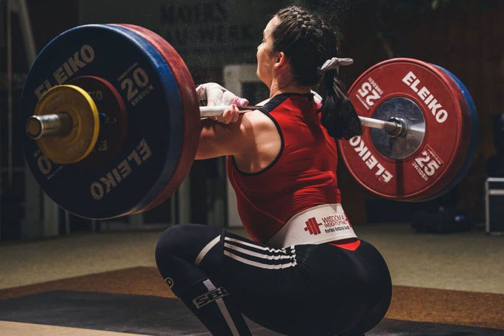 Team GB Olympic Weightlifter Sarah Davies Cleaning the Bar - View from Behind