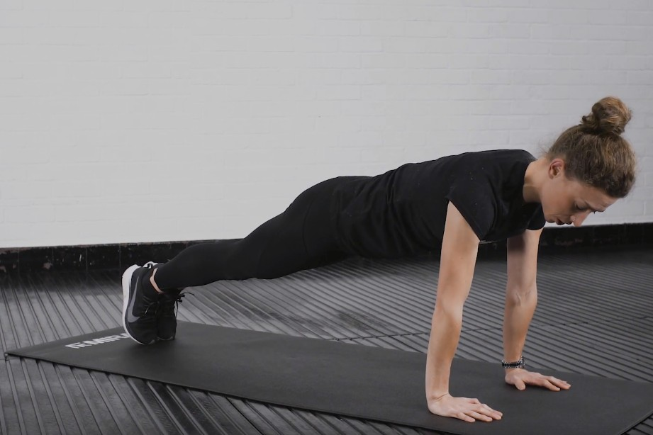 This is an image of triathlete, Becky Hair, demonstrating the dynamic plank exercise